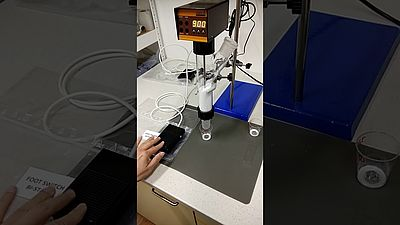 Automated powder dispensing with bistable footswitch