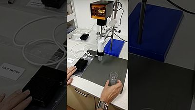 Automated dispensing of powder portions with DOSER and foot-switch in lab